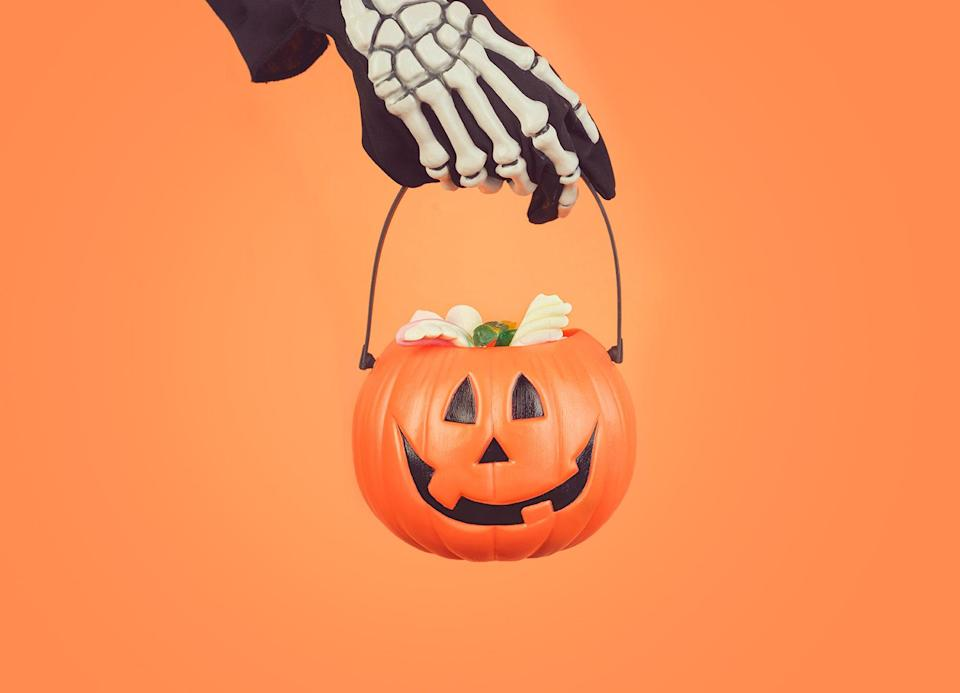 """<p>Move over, Easter baskets. Spooky baskets full of Halloween goodies are the new game in town. And this year they're especially prevalent: Because the COVID-19 pandemic has <a href=""""https://www.goodhousekeeping.com/holidays/halloween-ideas/a33985792/is-halloween-canceled/"""" rel=""""nofollow noopener"""" target=""""_blank"""" data-ylk=""""slk:changed, altered or canceled Halloween festivities"""" class=""""link rapid-noclick-resp"""">changed, altered or canceled Halloween festivities</a> in many towns, spooky baskets can ensure that kids still get plenty of treats (or tricks) on October 31. Parents can fill them with their family's favorite <a href=""""https://www.goodhousekeeping.com/holidays/halloween-ideas/g4630/best-new-halloween-treats/"""" rel=""""nofollow noopener"""" target=""""_blank"""" data-ylk=""""slk:Halloween candy"""" class=""""link rapid-noclick-resp"""">Halloween candy</a>, Halloween socks, chocolate-covered strawberries, reusable water bottles and even makeup items or game gift cards. Add in some plastic spiders or pumpkin doo-dads, cover the whole thing in fake cobwebs, and you've got yourself a perfect way to kick off Halloween.</p><p>Of course, kids don't get all of the spooky basket fun. You can always make one for a friend or significant other, and add some decidedly grown-up things, like scary movies coffee or tea, a personalized hot-drink tumbler or a small bottle of a little something to <a href=""""https://www.goodhousekeeping.com/food-recipes/a33645651/apple-cider-cocktail-recipe/"""" rel=""""nofollow noopener"""" target=""""_blank"""" data-ylk=""""slk:spike a hot apple cider"""" class=""""link rapid-noclick-resp"""">spike a hot apple cider</a>. (And there's no rule against making one for yourself. It counts as <a href=""""https://www.goodhousekeeping.com/health/wellness/g25643343/self-care-ideas/"""" rel=""""nofollow noopener"""" target=""""_blank"""" data-ylk=""""slk:self-care"""" class=""""link rapid-noclick-resp"""">self-care</a>.) Then, after the kids go to bed, you can crack them open and enjoy an adult Halloween treat (and you don't have to sn"""