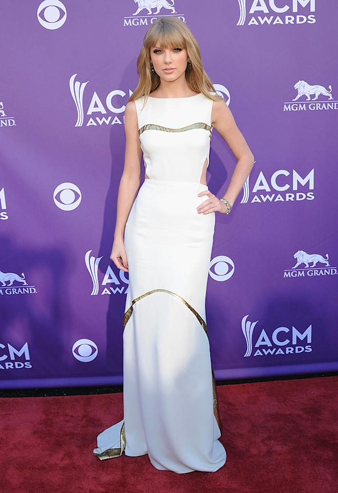 Taylor Swift, 22, was sophisticated — though not terribly exciting — in a white column gown with cutouts and gold accents, as well as a simple down 'do. Unfortunately, the Entertainer of the Year nominee was without her previously arranged date, 18-year-old leukemia patient Kevin McGuire, because he was hospitalized on Saturday and couldn't attend.