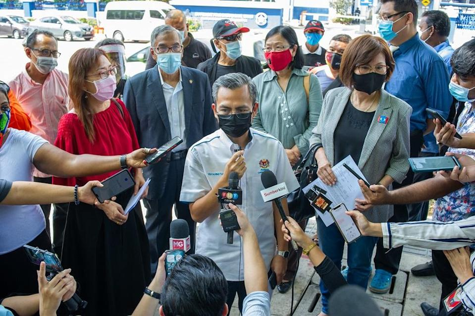 Lembah Pantai MP Fahmi Fadzil (centre) and the other Pakatan Harapan MPs speak to reporters outside the Dang Wangi police station in Kuala Lumpur May 4, 2021. ― Picture by Shafwan Zaidon