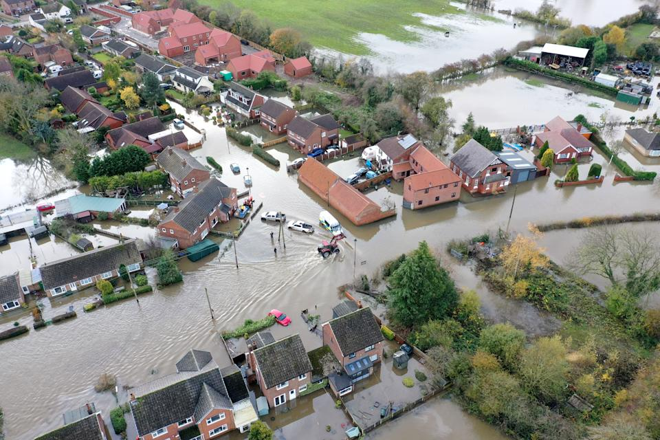 A view of the flood water at Fishlake, in Doncaster, South Yorkshire, as parts of England endured a month's worth of rain in 24 hours, with scores of people rescued or forced to evacuate their homes.