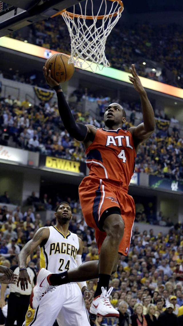 Atlanta Hawks' Paul Millsap (4) goes up for a shot against the Indiana Pacers during the first half in Game 5 of an opening-round NBA basketball playoff series Monday, April 28, 2014, in Indianapolis. (AP Photo/Darron Cummings)