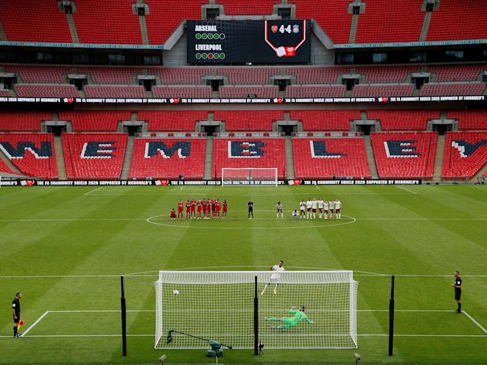 Arsenal's Pierre-Emerick Aubameyang scores a penalty to win the penalty shootout and the FA Community Shield in a match against Liverpool, as play resumes behind closed doors following the outbreak of the coronavirus disease (COVID-19) outbreak, at Wembley Stadium in London, Britain, August 29, 2020. Pool via REUTERS/Andrew Couldridge