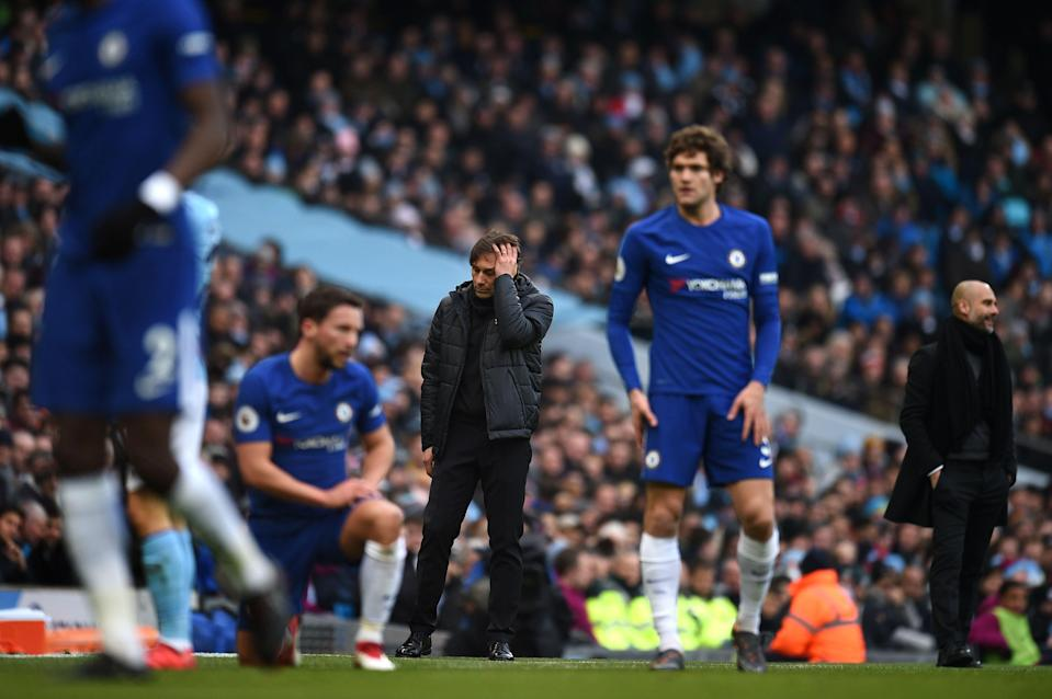 Antonio Conte and Chelsea players react during a 1-0 loss to Manchester City. (Getty)