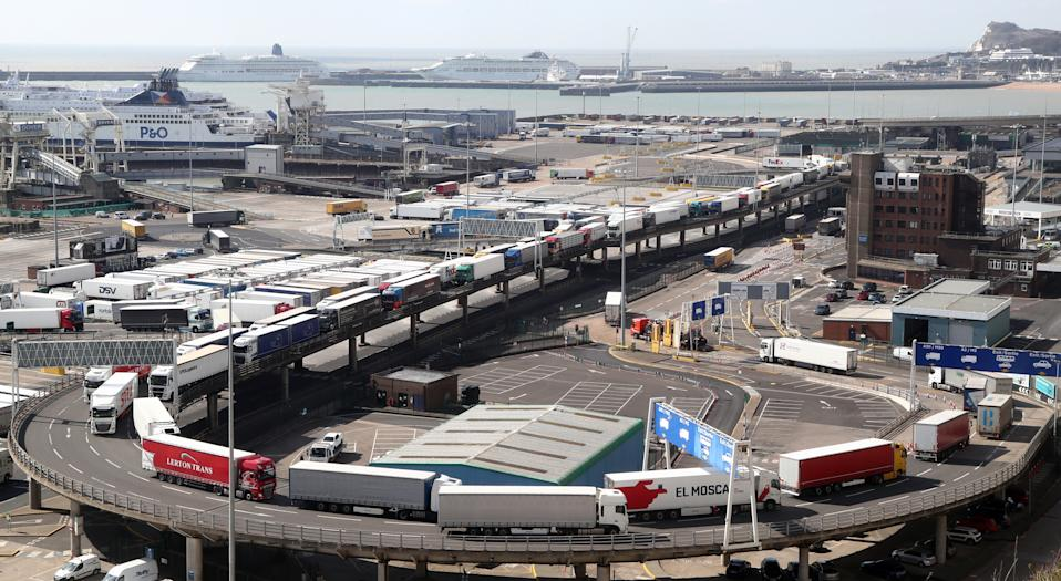 Freight lorries queue to leave the Port of Dover in Kent after arriving by ferry to deliver goods across the UK as the country continues in lockdown to help curb the spread of the coronavirus.