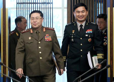 North Korean Lieutenant General An Ik San walks with South Korean Major General Kim Do-gyun at the Peace House of the border village of Panmunjom South Korea