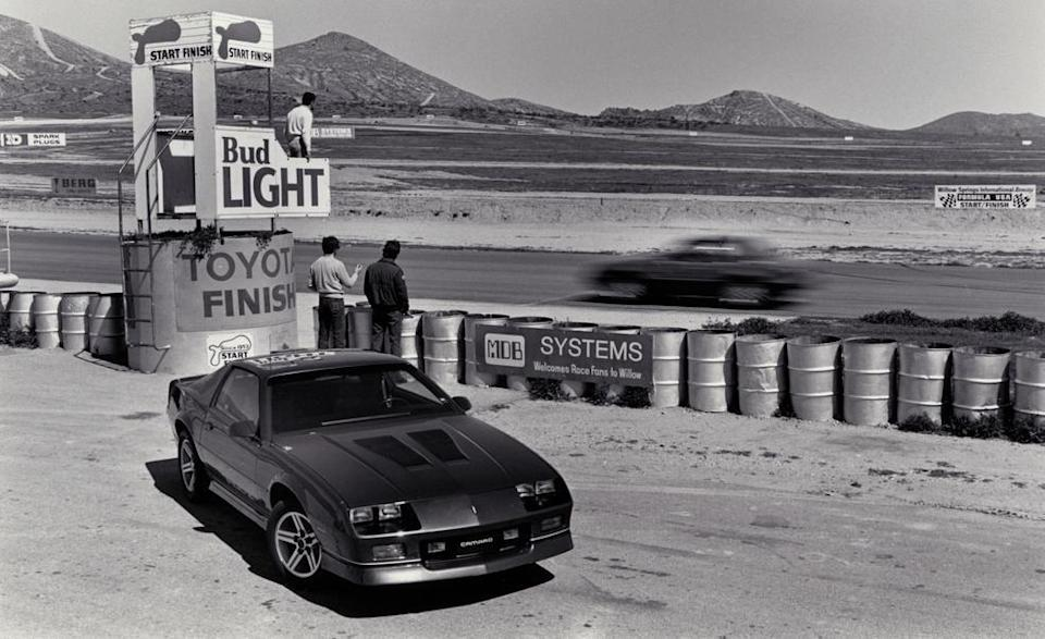 """<p>The high-output Camaro came with the Corvette's 5.7-liter V-8 (slightly detuned to 220 horsepower) and was introduced with the goal of knocking Ford's pony car off its pedestal. While that didn't exactly happen, with the Camaro IROC-Z losing <a href=""""http://www.caranddriver.com/comparisons/1986-ford-mustang-lx-50-vs-chevrolet-camaro-iroc-z-archived-comparison-test"""" rel=""""nofollow noopener"""" target=""""_blank"""" data-ylk=""""slk:its first Car and Driver comparison test"""" class=""""link rapid-noclick-resp"""">its first <em>Car and Driver</em> comparison test</a> against the Mustang 5.0, this Chevy still has a permanent place in our '80s-lovin' hearts. <em>—Alexander Stoklosa</em></p>"""