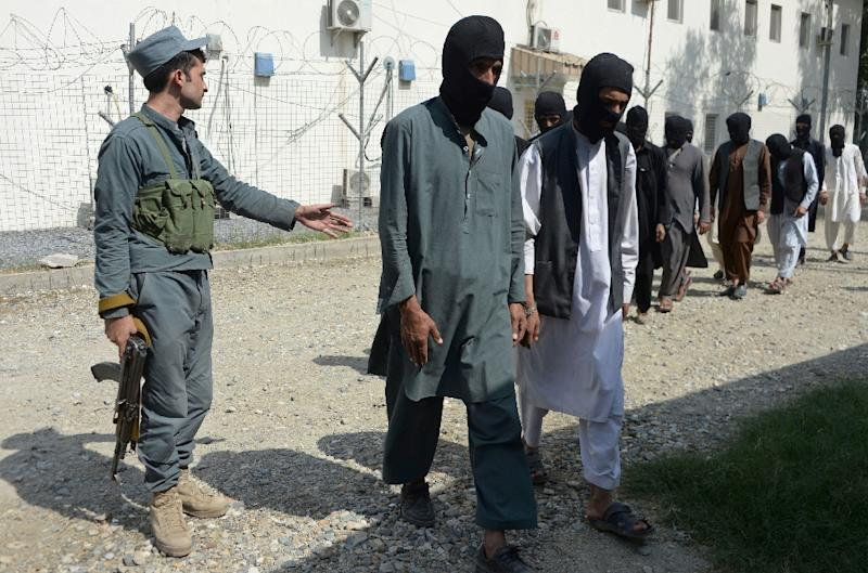 Afghan security forces escorting alleged Islamic State group fighters and Taliban in Jalalabad, amid reports that French and Algerian fighters, some arriving from Syria, have joined the jihadist group in northern Afghanistan (AFP Photo/NOORULLAH SHIRZADA)