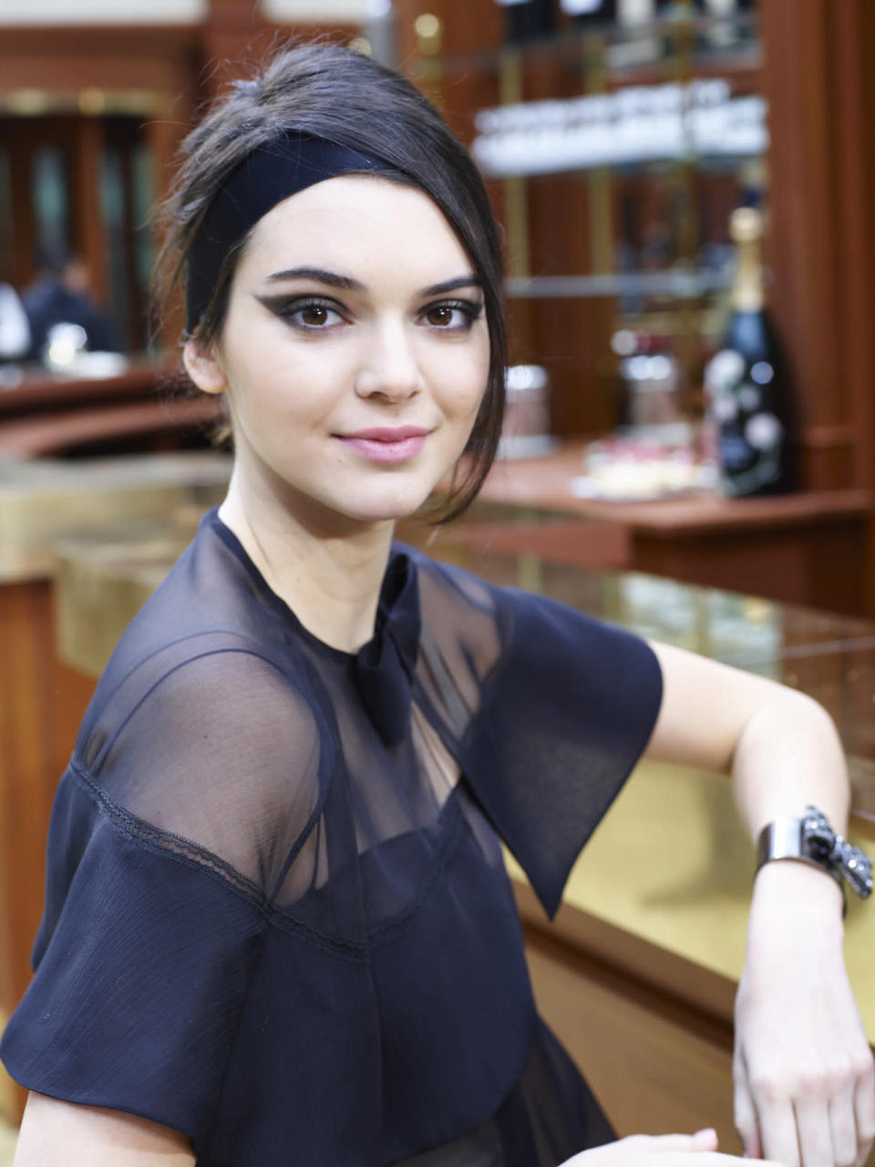 <p>Modeling at Chanel Fall 2015 in Paris, Jenner channels the modern-day French girl in smoky winged-tip eyeliner and a velvet black ribbon in her hair. <i>(Photo: Getty Images)</i></p>