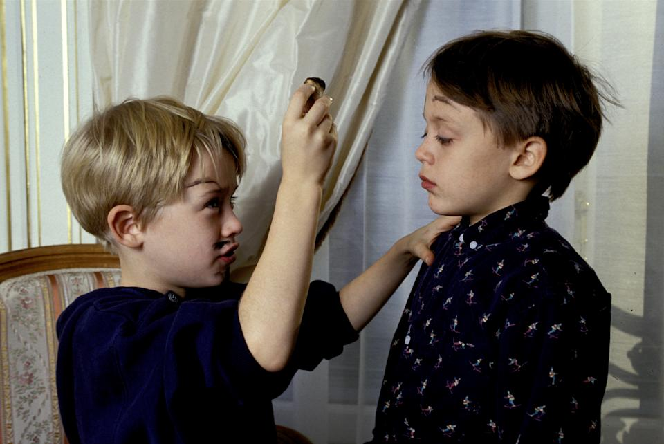 Paris, France - 11 December 1990, American actor Macaulay Culkin in his hotel room in Paris clowns around with his brother Kieran and paints his face with a wine cork.   (Photo by Francis Apesteguy/Getty Images)