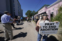 The city of Jackson, anticipated a large anti-abortion protest outside the Jackson Women's Health Organization clinic in Jackson, Miss., and shut down part of the street, Wednesday, Sept. 22, 2021. The clinic is the state's only medical facility able to provide abortions on demand. However, the group of anti-abortion advocates that gathered outside the clinic was small, prayerful and peaceful. (AP Photo/Rogelio V. Solis)