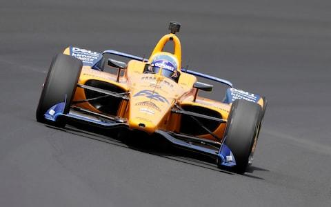 Fernando Alonso, of Spain, drives through turn one during practice for the Indianapolis 500 IndyCar auto race at Indianapolis Motor Speedway - Credit: AP