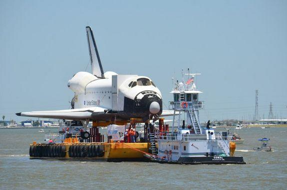 """The space shuttle replica formerly known as """"Explorer"""" approaches a dock in Clear Lake, Houston after arriving in Houston on June 1, 2012. The shuttle will be delivered to Space Center Houston for public display."""