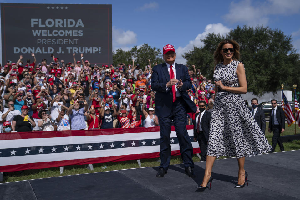 President Donald Trump and first lady Melania Trump arrive for a campaign rally outside Raymond James Stadium, Thursday, Oct. 29, 2020, in Tampa. (AP Photo/Evan Vucci)