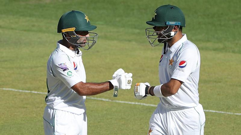 Pakistan's Babar Azam (R) and Asad Shafiq (L) have hit half-centuries in the match with Australia A