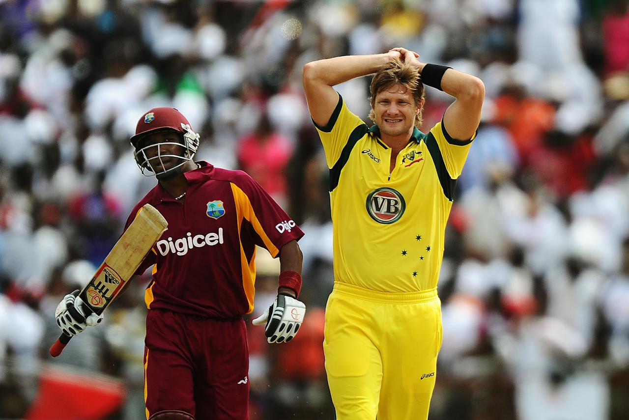 Australian cricket team's stand-in captain Shane Watson (R) reacts as West Indies batsman Dwayne Bravo takes a run during the third-of-five One Day International (ODI) matches between West Indies and Australia at the Arnos Vale Ground in Kingstown on March 20, 2012. Australia have scored 220/10 at the end of their innings. AFP PHOTO/Jewel Samad (Photo credit should read JEWEL SAMAD/AFP/Getty Images)