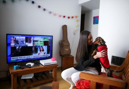 Nunes plays with her dog in her house in Buenos Aires