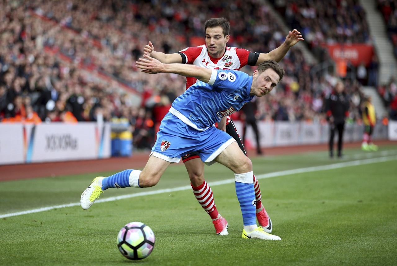 <p>Southampton's Cedric Soares and AFC Bournemouth's Dan Gosling, front, battle for the ball </p>
