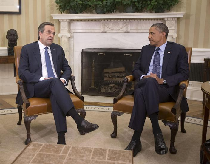 """President Barack Obama meets with Greek Prime Minister Antonis Samaras in the Oval Office of the White House in Washington, Thursday, Aug. 8, 2013. The White House said the meeting will """"underscore ongoing support for Greece's efforts to reform its economy and promote a return to prosperity.""""(AP Photo/Pablo Martinez Monsivais)"""