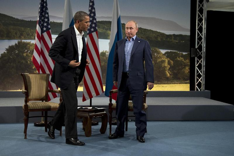 President Barack Obama and Russian President Vladimir Putin get up to leave after their meeting in Enniskillen, Northern Ireland, Monday, June 17, 2013. Obama and Putin discussed the ongoing conflict in Syria during their bilateral meeting. (AP Photo/Evan Vucci)