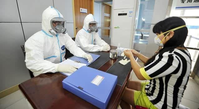 Quarantine officers attend an excercise to prevent Ebola virus. Photo: Getty