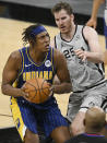 Indiana Pacers' Myles Turner, left, drives against San Antonio Spurs' Jakob Poeltl during the second half of an NBA basketball game on Saturday, April 3, 2021, in San Antonio. (AP Photo/Darren Abate)
