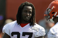 FILE - In this July 25, 2019, file photo, Cleveland Browns running back Kareem Hunt, left, talks with running back Nick Chubb during practice at the NFL football team's training camp facility, in Berea, Ohio. Hunts self-inflicted punishment is over. The Browns running back, who quickly went from being one of the NFLs rising stars to a violent offender, has returned from his eight-game NFL suspension and will play this week against the Buffalo Bills. (AP Photo/Tony Dejak, File)