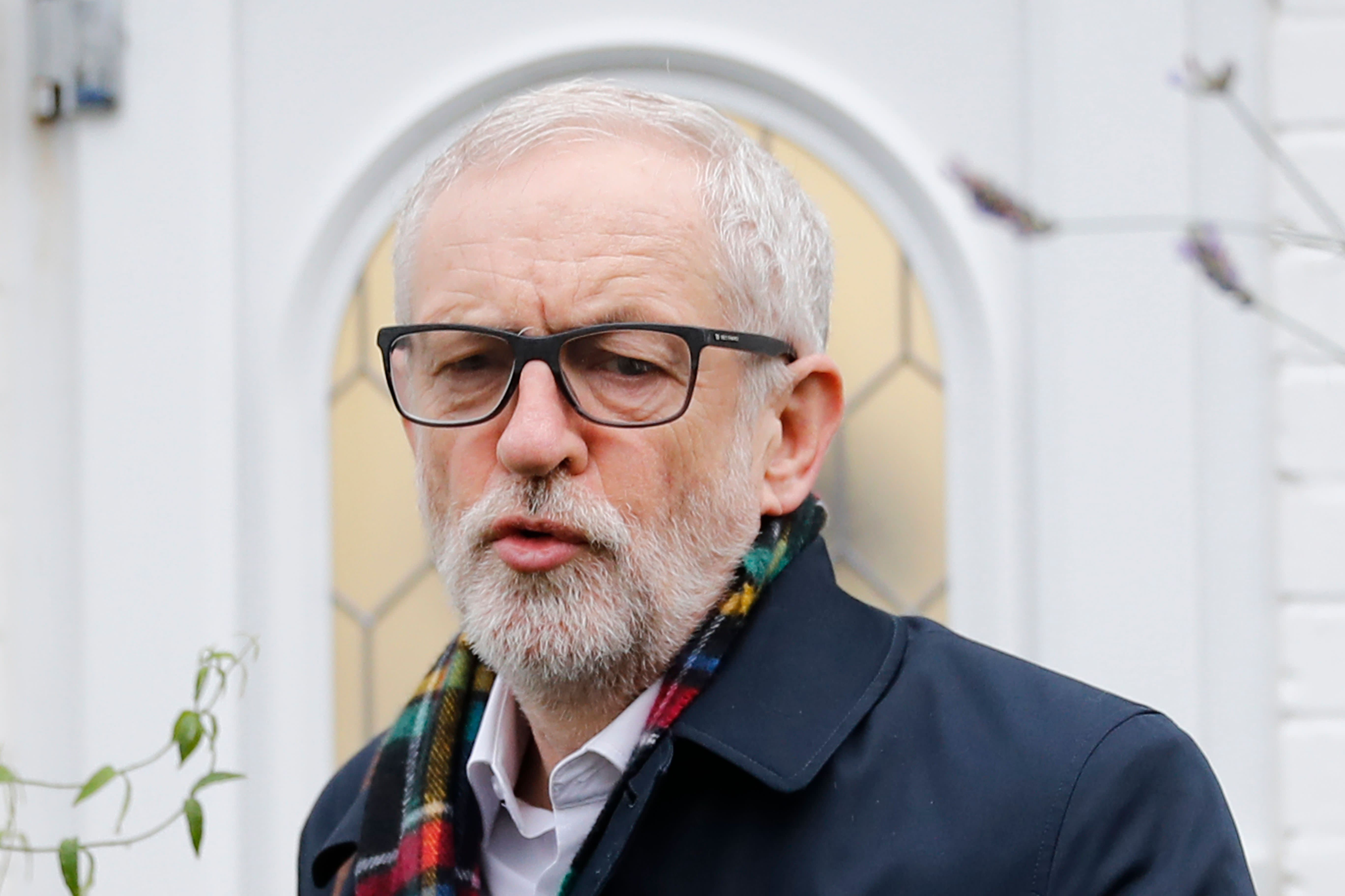 Britain's opposition Labour Party leader Jeremy Corbyn leaves his home in north London on December 17, 2019 for the first full day of the new parliament following the general election. - Corbyn will face Prime Minister Boris Johnson in the House of Commons today after Labour was handed its worst defeat in a general election since World war II, forcing the Labour leader to announce a plan for his departure. He also faces a potentially uncomfortable meeting with his own Labour colleagues later in the day. (Photo by Tolga AKMEN / AFP) (Photo by TOLGA AKMEN/AFP via Getty Images)