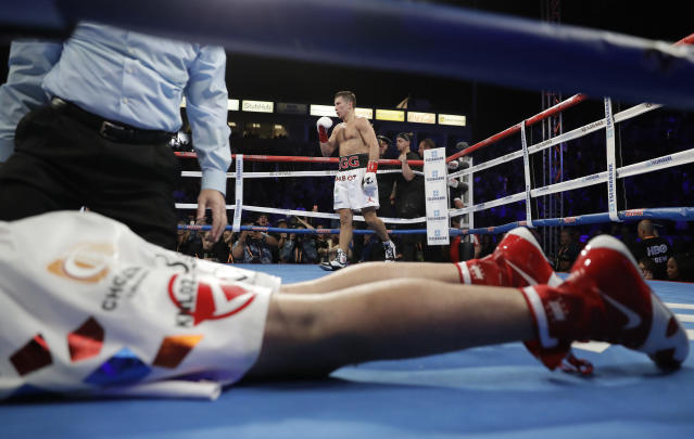 Gennady Golovkin celebrates after knocking down Vanes Martirosyan in their middleweight world championship boxing match Saturday, May 5, 2018, in Carson, Calif. Golovkin won the bout. (AP Photo/Chris Carlson)