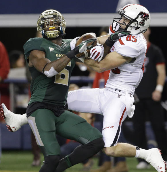 Texas Tech wide receiver Jordan Davis (85) catches a pass against Baylor safety Ahmad Dixon (6) during the first half of an NCAA college football game in Arlington, Texas, Saturday, Nov. 16, 2013. (AP Photo/LM Otero)