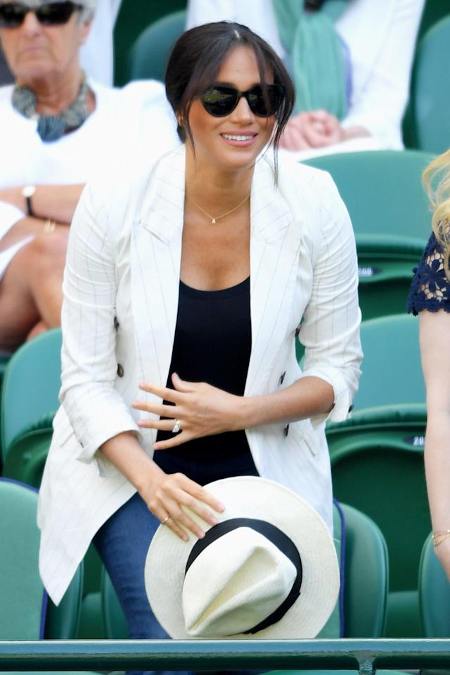"""Meghan enjoyed some more sports action on July 4, <a href=""""https://people.com/royals/meghan-markle-attends-wimbledon-watch-serena-williams/"""" rel=""""nofollow noopener"""" target=""""_blank"""" data-ylk=""""slk:heading to Wimbledon"""" class=""""link rapid-noclick-resp"""">heading to Wimbledon</a> to watch her good friend Serena Williams play."""