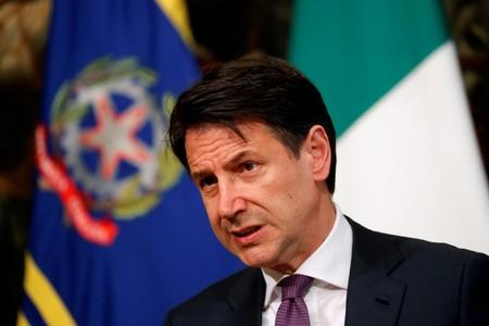 Italy determined to avoid EU debt action, will respect rules - PM