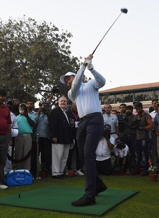 Historic drive: Asian Tour chief operating officer Cho Minn Thant hits opening ceremonial tee shot as international golf returned to Pakistan for the first time in 11 years (AFP Photo/ASIF HASSAN)