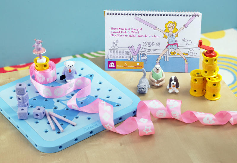 "This August 2012 photo released by GoldieBlox, Inc., shows the toy items from ""GoldieBlox and the Spinning Machine,"" photographed in San Francisco. The toy's main character is a female engineer named Goldie, and is designed to spark an interest by girls in science and engineering. It is scheduled to be on store shelves in April 2013. (AP Photo/Susan Burdick)"