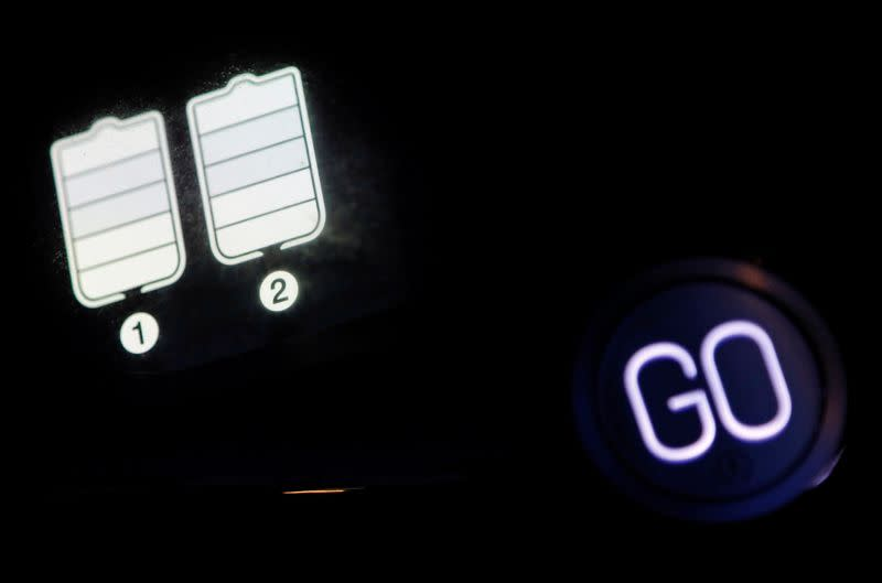 An instrument panel shows batteries residual quantity in a Gogoro's electric scooter in Taipei