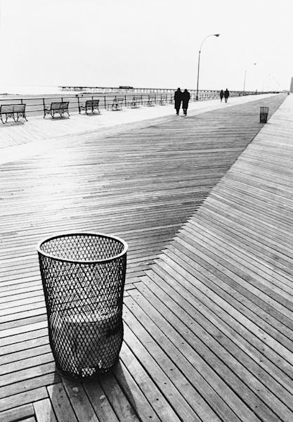 FILE - This Oct. 30, 1971 file photo shows the wooden boardwalk that connects Brighton Beach with Coney Island, in the Brooklyn borough of New York. A hearing is taking place in New York City Monday, March 12, 2012 on a planned makeover for stretches of the aging, 2.7-mile boardwalk that would include replacing it with a combination of plastic and concrete. (AP Photo/George Ridgeway, File)