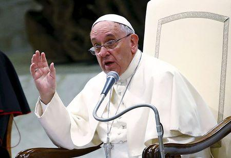 File photo of Pope Francis gesturing as he talks at the Vatican
