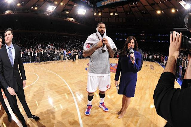 NEW YORK - JANUARY 24: Carmelo Anthony #7 of the New York Knicks is interviewed after scoring 62 points during the game against the Charlotte Bobcats on January 24, 2014 at Madison Square Garden in New York City. (Photo by David Dow NBAE via Getty Images)