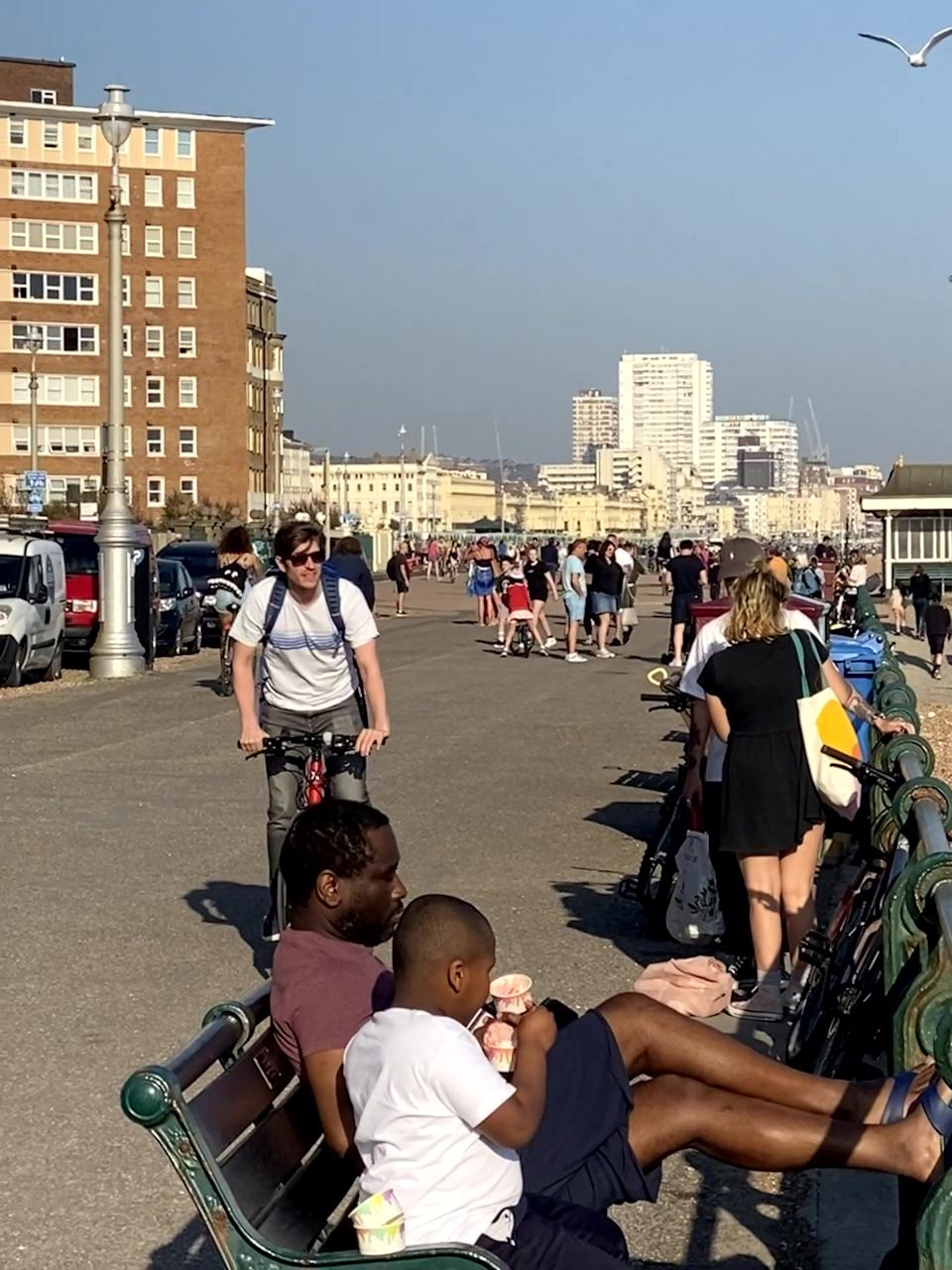 This photo shows a totally packed seafront as lockdown fatigue sets in with fed up Brits starting to breach distancing guidelines. Hundreds of locals were seen strolling along the Hove seafront in East Sussex to enjoy the sunshine, flouting the state-recommended 2m social distancing guidelines. See SWNS story SWTPbusy. The snap, taken yesterday (Thurs) at 6pm shows Brits sitting on benches enjoying ice cream and group gatherings after temperatures soared to 23 degrees.  Earlier today (Fri) Health Secretary Matt Hancock warned it was still too soon for UK lockdown measures to be relaxed.