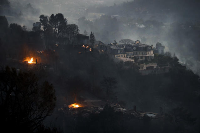 <p>A mansion that survived a wildfire sits on a hilltop in the Bel Air district of Los Angeles Wednesday, Dec. 6, 2017. (Photo: Jae C. Hong/AP) </p>