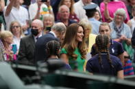 Kate, Duchess of Cambridge, walks for the presentation ceremony for the women's singles on day twelve of the Wimbledon Tennis Championships in London, Saturday, July 10, 2021. (AP Photo/Alberto Pezzali)
