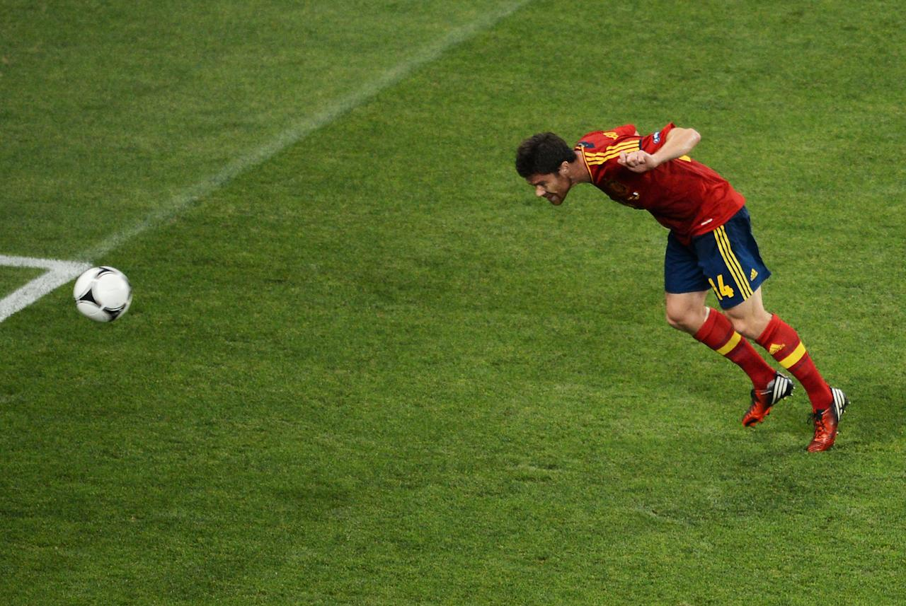 DONETSK, UKRAINE - JUNE 23:  Xabi Alonso of Spain scores the first goal during the UEFA EURO 2012 quarter final match between Spain and France at Donbass Arena on June 23, 2012 in Donetsk, Ukraine.  (Photo by Jasper Juinen/Getty Images)