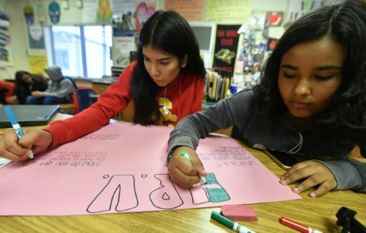 Students work on posters about sexual health at James Monroe High School in the Los Angeles suburb of North Hills