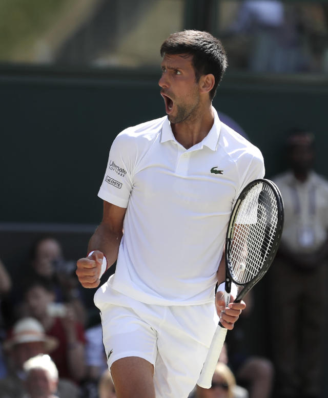 Serbia's Novak Djokovic celebrates winning a game against Spain's Roberto Bautista Agut during a men's singles semifinal match on day eleven of the Wimbledon Tennis Championships in London, Friday, July 12, 2019. (AP Photo/Ben Curtis)
