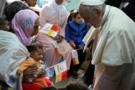 Pope Francis met unwell children at a health centre on Sunday morning