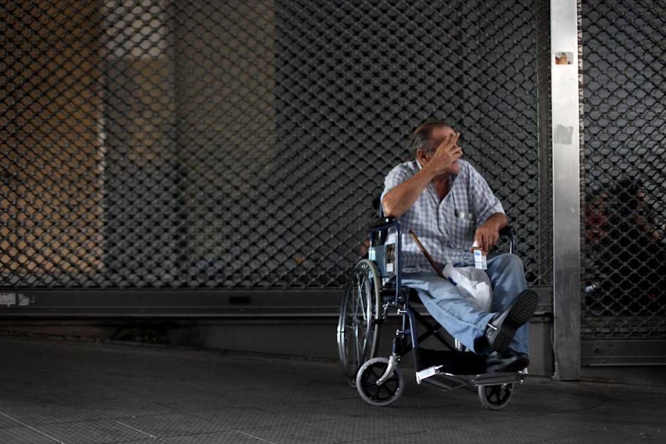 A disabled protester sits in a wheelchair during a rally outside the Finance Ministry in Athens, on Thursday, Sept. 13, 2012. Disabled groups are angry at likely benefit cuts under a major new austerity program demanded by international rescue creditors. (AP Photo/Petros Giannakouris)
