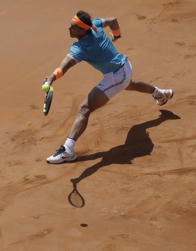 Spain's Rafael Nadal returns the ball during his match against France's Jeremy Chardy at the Italian Open tennis tournament, in Rome, Thursday, May, 16, 2019. (AP Photo/Alessandra Tarantino)