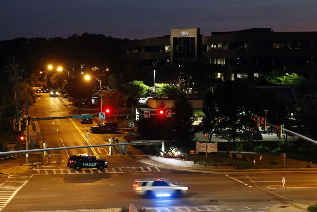 <p>An emergency vehicle blocks a road leading to the scene of a shooting at The Capital Gazette newspaper's offices at dawn, Friday, June 29, 2018, in Annapolis, Md. (Photo: Patrick Semansky/AP) </p>