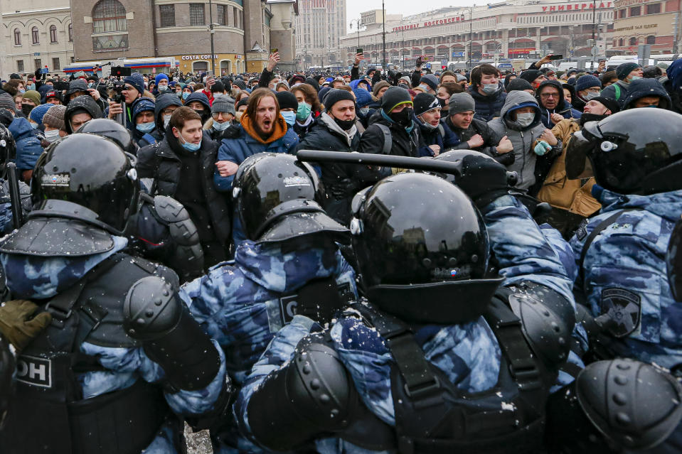 FILE - In this Sunday, Jan. 31, 2021 file photo, people clash with police during a protest against the jailing of opposition leader Alexei Navalny in Moscow, Russia. A prison sentence for Russian opposition leader Alexei Navalny and a sweeping crackdown on protesters demanding his release reflect the Kremlin's steely determination to fend off threats to its political monopoly at any cost. (AP Photo/Alexander Zemlianichenko, File)