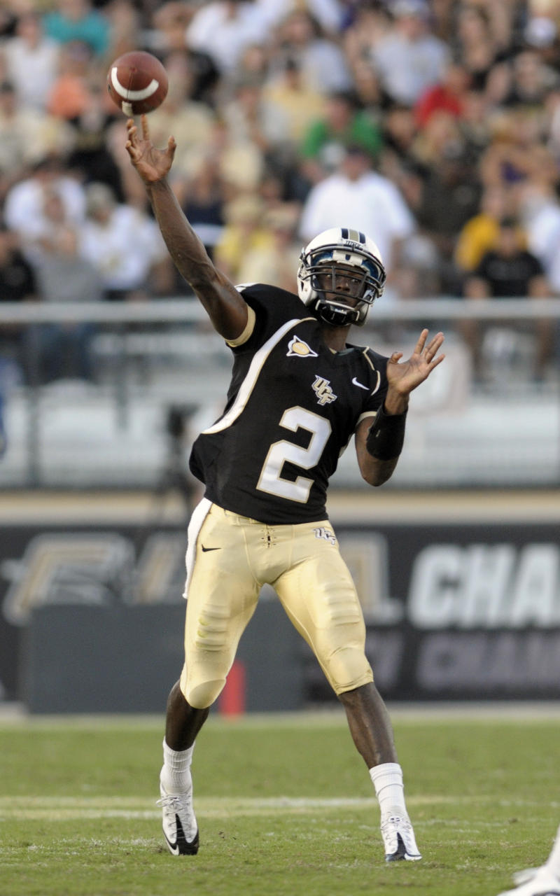 In this photo taken Oct. 30, 2010,  Central Florida quarterback Jeff Godfrey throws a pass during an NCAA college football game against East Carolina in Orlando, Fla. Starting as a true freshman quarterback, Godfrey has guided No. 25 Central Florida to its first national ranking. (AP Photo/Phelan M. Ebenhack)