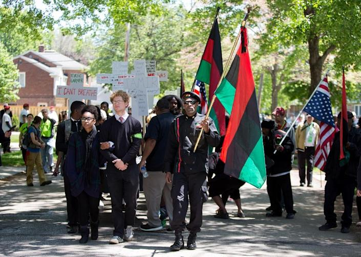 People march in protest, in reaction to Cleveland police officer Michael Brelo being acquitted of manslaughter charges after he shot two people at the end of a 2012 car chase, on May 23, 2015 in Cleveland, Ohio (AFP Photo/Ricky Rhodes)